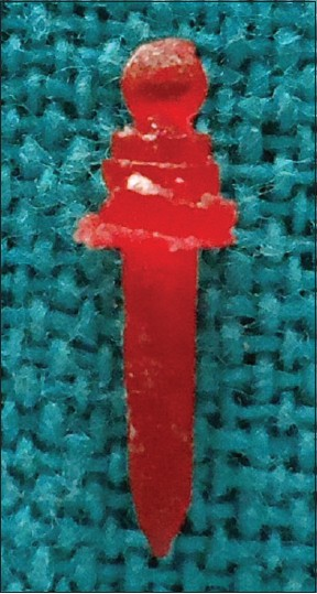 Figure 2: Wax pattern with ball attached to the post